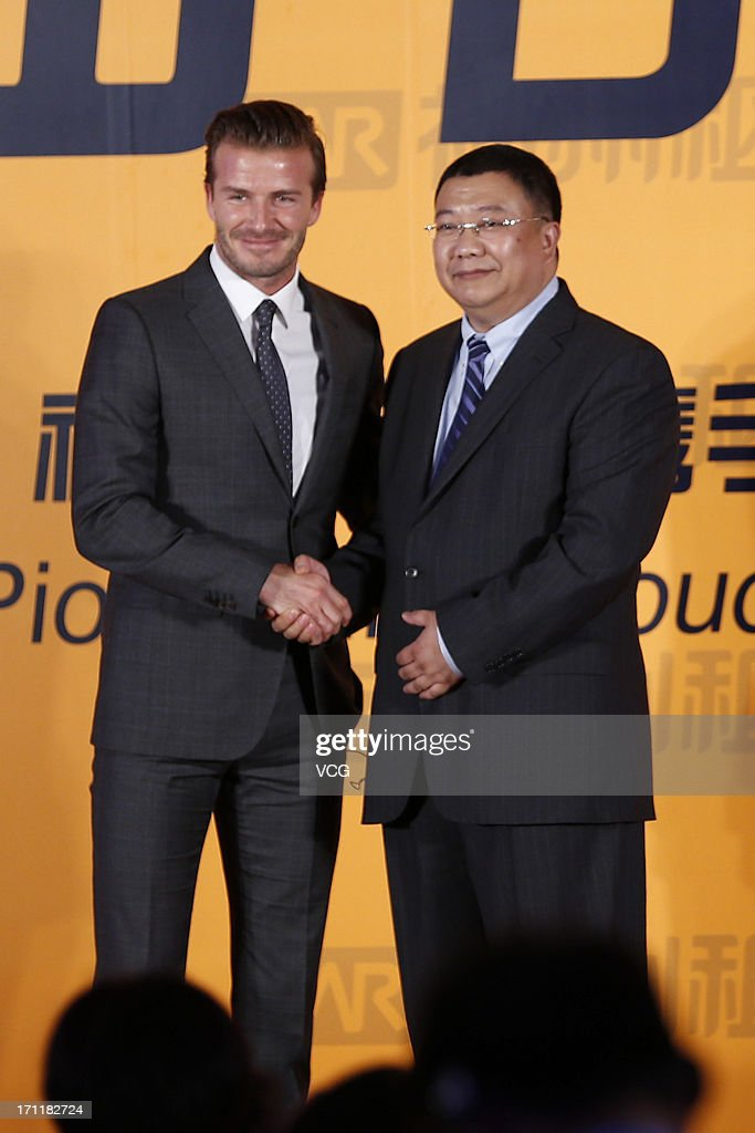 David Beckham shakes hands with China Auto Rental Holdings Inc CEO Lu Zhengyao (R) during a press conference as he signs a contract with China Auto Rental Holdings Inc on June 23, 2013 in Beijing, China.