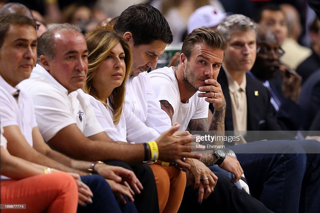 David Beckham sits courtside as he watches the Miami Heat play against the Indiana Pacers during Game Seven of the Eastern Conference Finals of the 2013 NBA Playoffs at AmericanAirlines Arena on June 3, 2013 in Miami, Florida.