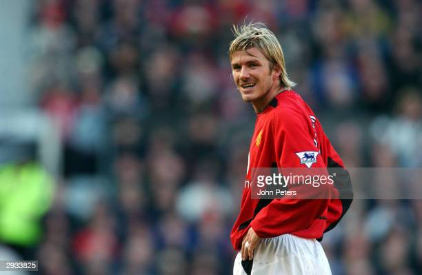 David Beckham smiles at the camera after his free kick hits the woodwork during the FA Cup Fourth Round match between Manchester United v Portsmouth...
