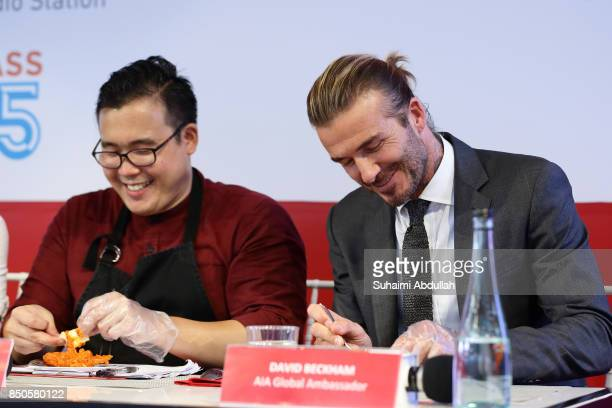 David Beckham takes part in a food tasting session with MasterChef Asia Winner Woo Wai Leong during the AIA Vitality Healthy Cookout Showdown on...