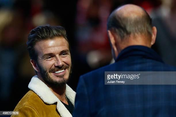 David Beckham talks to former tennis player Stan Smith after the men's semi final between Stanislas Wawrinka of Switzerland and Roger Federer of...