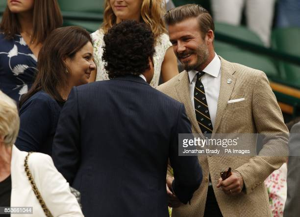 David Beckham talks to Sachin Tendulkar in the Royal Box on Centre Court during day six of the Wimbledon Championships at the All England Lawn Tennis...