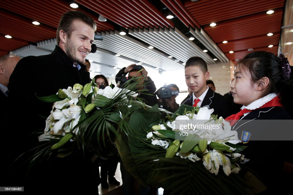<a gi-track='captionPersonalityLinkClicked' href=/galleries/search?phrase=David+Beckham&family=editorial&specificpeople=158480 ng-click='$event.stopPropagation()'>David Beckham</a> talks with students of Shijia Hutong Primary School as he arrives at Beijing Capital International Airport on March 20, 2013 in Beijing, China.
