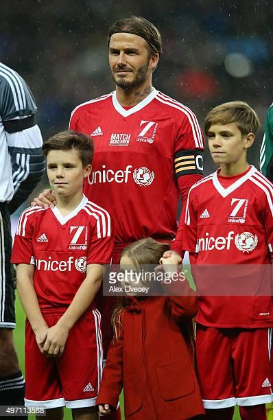 David Beckham the Captain of Great Britain Ireland his children Cruz Beckham Harper Beckham and Romeo Beckham pose for the cameras prior to kickoff...