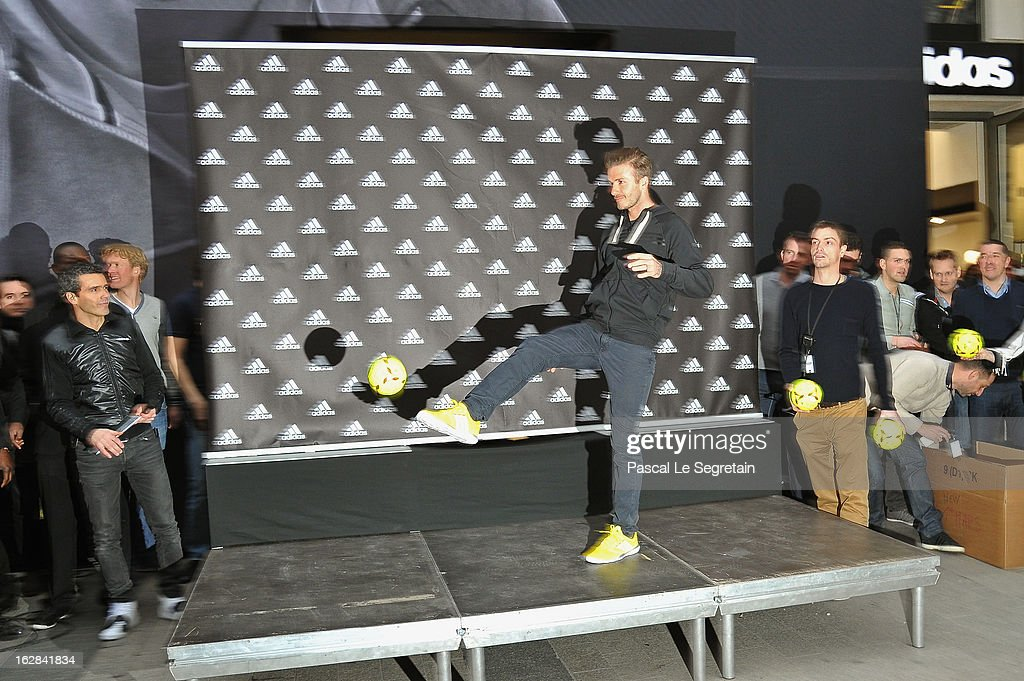 <a gi-track='captionPersonalityLinkClicked' href=/galleries/search?phrase=David+Beckham&family=editorial&specificpeople=158480 ng-click='$event.stopPropagation()'>David Beckham</a> (r) throws a ball towards fans as he attends an autograph session at adidas Performance Store Champs-Elysees on February 28, 2013 in Paris, France.