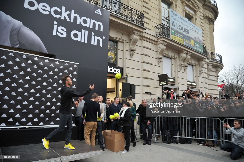 <a gi-track='captionPersonalityLinkClicked' href=/galleries/search?phrase=David+Beckham&family=editorial&specificpeople=158480 ng-click='$event.stopPropagation()'>David Beckham</a> (L) throws a ball towards fans as he attends an autograph session at adidas Performance Store Champs-Elysees on February 28, 2013 in Paris, France.