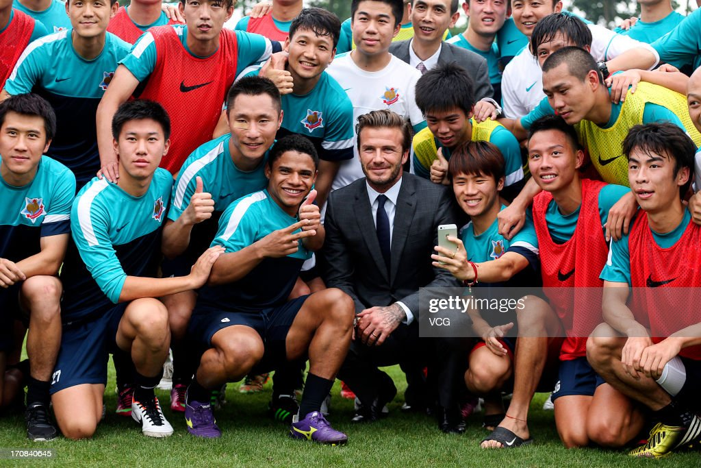 <a gi-track='captionPersonalityLinkClicked' href=/galleries/search?phrase=David+Beckham&family=editorial&specificpeople=158480 ng-click='$event.stopPropagation()'>David Beckham</a> visits Shanghai Shenxin F.C. on June 19, 2013 in Shanghai, China.