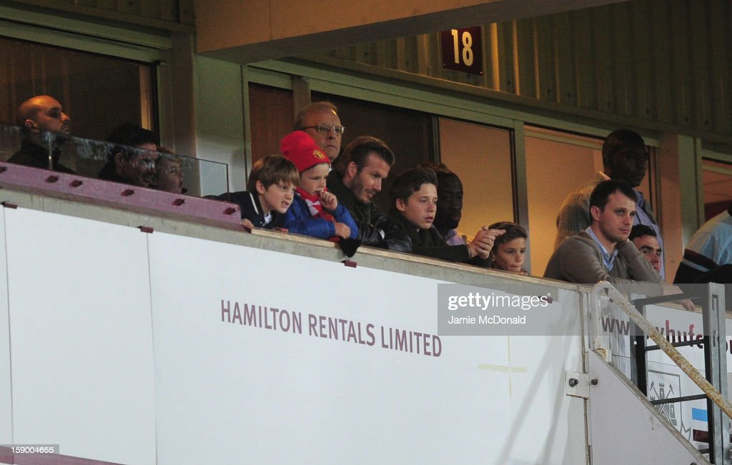 <a gi-track='captionPersonalityLinkClicked' href=/galleries/search?phrase=David+Beckham&family=editorial&specificpeople=158480 ng-click='$event.stopPropagation()'>David Beckham</a> watches the FA Cup with Budweiser Third Round match between West Ham United and Manchester United at the Boleyn Ground on January 5, 2013 in London, England.
