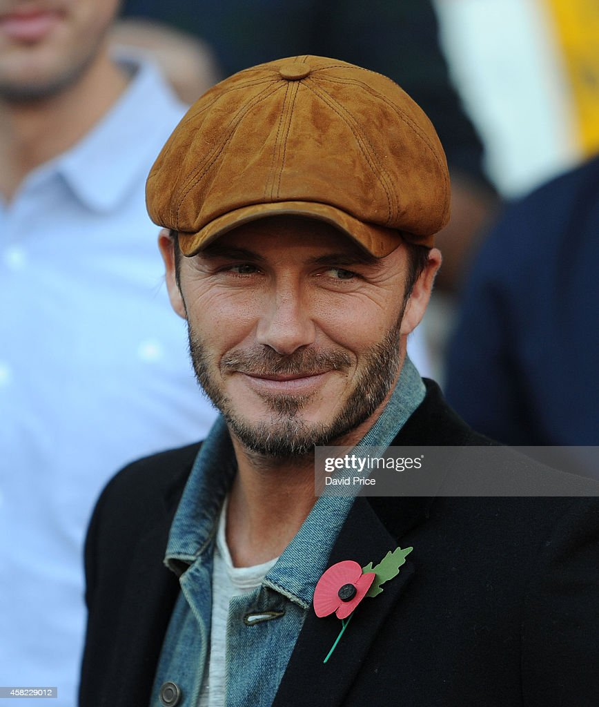David Beckham watches the match between Arsenal and Burnley in the Barclays Premier League at Emirates Stadium on November 1, 2014 in London, England.