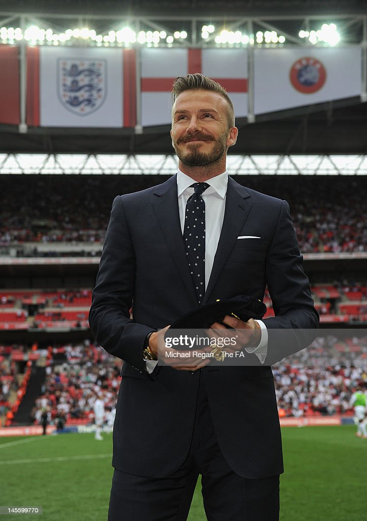 <a gi-track='captionPersonalityLinkClicked' href=/galleries/search?phrase=David+Beckham&family=editorial&specificpeople=158480 ng-click='$event.stopPropagation()'>David Beckham</a>, who has over 100 caps for England, poses on the pitch at half time during a presentation of a commemorative cap and medal during the International Friendly match between England and Belgium at Wembley Stadium on June 2, 2012 in London, England.
