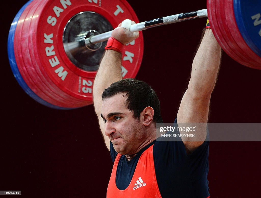 David Bedzhanyan of Russia competes in the men's 105 kg weightlifting IWF World Championships at Centennial Hall in Wroclaw, Poland on October 27, 2013. David Bedzhanyan won the silver medal in the competition .