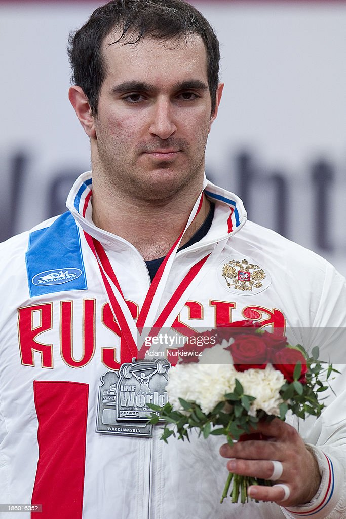 David Bedzhanyan of Russia poses with silver medal in the total competition men's 105 kg Group A during the IWF World Weightlifting Championships Wroclaw 2013 at Centennial Hall on October 27, 2013 in Wroclaw, Poland.