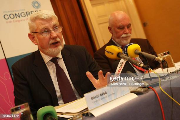 David Begg left of the Irish Congress of Trade Unions speaks during a meeting at Buswells Hotel Dublin