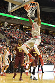 David Bell of the Ohio State Buckeyes slams in two points in the second half as Bakary Konate of the Minnesota Golden Gophers watches on December 30...
