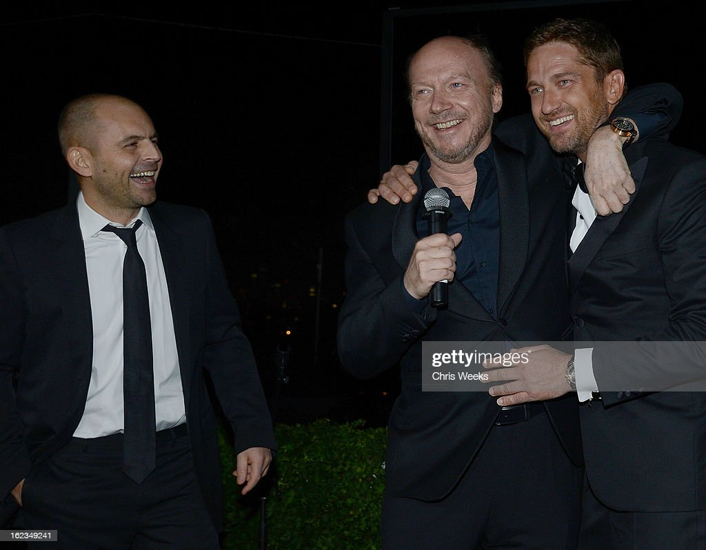 David Belle, Screenwriter <a gi-track='captionPersonalityLinkClicked' href=/galleries/search?phrase=Paul+Haggis&family=editorial&specificpeople=213967 ng-click='$event.stopPropagation()'>Paul Haggis</a> and actor <a gi-track='captionPersonalityLinkClicked' href=/galleries/search?phrase=Gerard+Butler+-+Actor&family=editorial&specificpeople=202258 ng-click='$event.stopPropagation()'>Gerard Butler</a> attend the Hollywood Domino and Bovet 1822 Gala benefiting Artists For Peace And Justice at Sunset Tower on February 21, 2013 in West Hollywood, California.