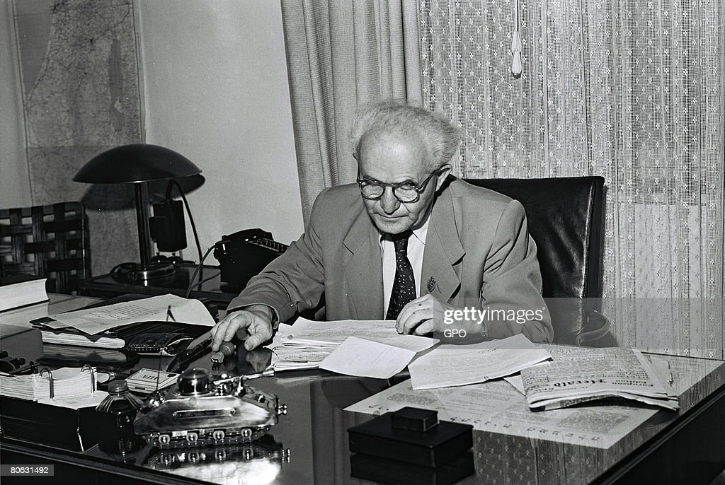 David Ben Gurion, the first Prime Minister of the Jewish State, in his office September 1, 1949 in Tel Aviv, Israel. The model of a tank on his desk is a cigarette box and lighter given to him by an Israeli soldier.