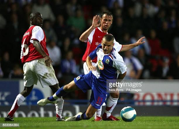 David Bentley Blackburn Rovers falls in the tackle from MyPa's Kuami Agboh and Nebi Mustafi
