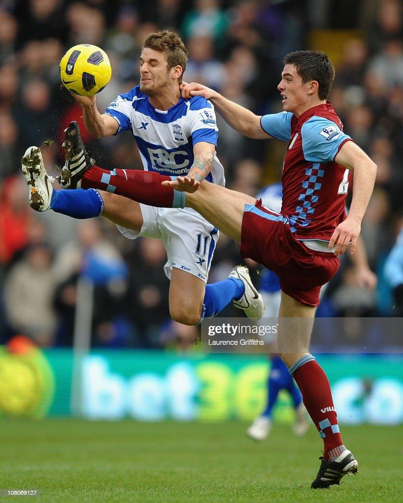 David Bentley of Birmingham City battles with Ciaran Clark of Aston Villa during the Barclays Premier League match between Birmingham City and Aston...