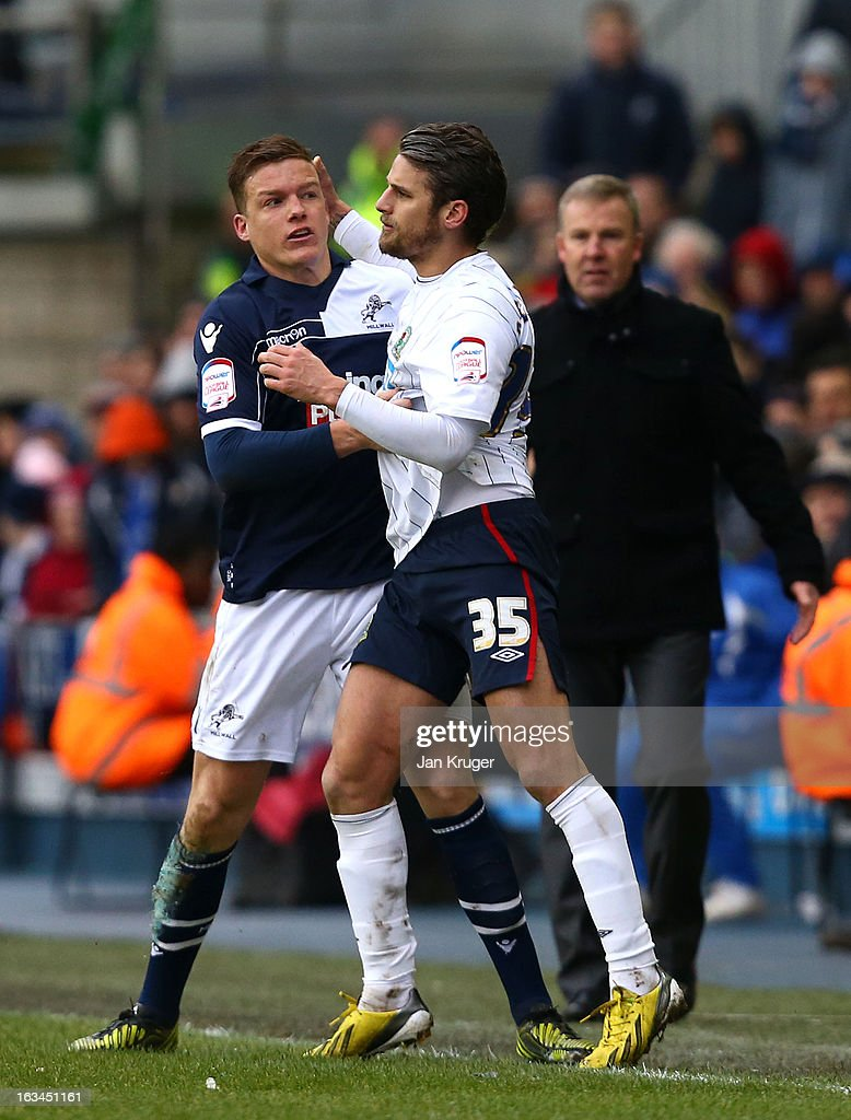 <a gi-track='captionPersonalityLinkClicked' href=/galleries/search?phrase=David+Bentley&family=editorial&specificpeople=214578 ng-click='$event.stopPropagation()'>David Bentley</a> of Blackburn Rovers and <a gi-track='captionPersonalityLinkClicked' href=/galleries/search?phrase=Shane+Lowry+-+Fu%C3%9Fballspieler&family=editorial&specificpeople=12866006 ng-click='$event.stopPropagation()'>Shane Lowry</a> of Millwall square up during the FA Cup sponsored by Budweiser sixth round match between Millwall and Blackburn Rovers at The Den on March 10, 2013 in London, England.