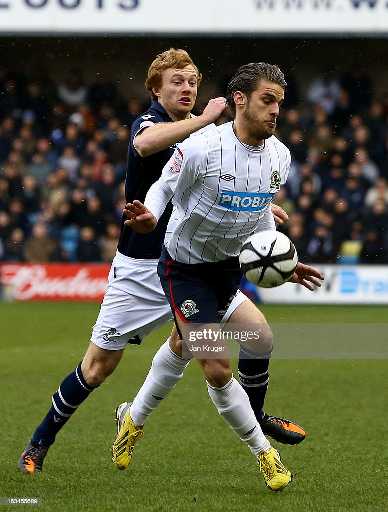 David Bentley of Blackburn Rovers battles with Chris Taylor of Millwall during the FA Cup sponsored by Budweiser sixth round match between Millwall and Blackburn Rovers at The Den on March 10, 2013 in London, England.