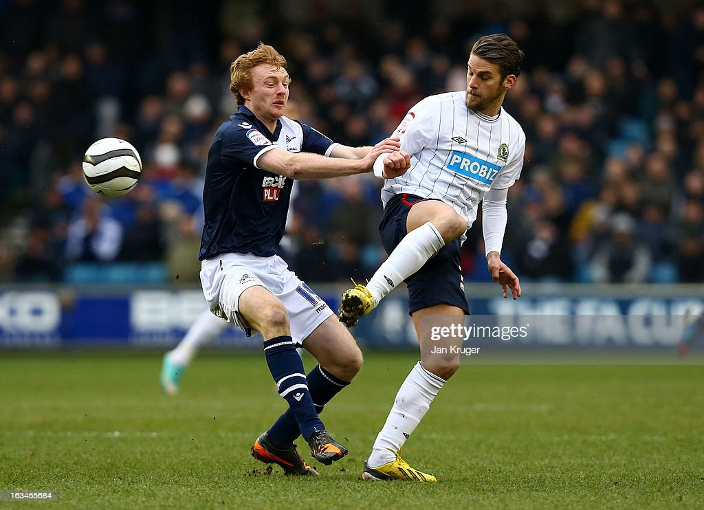 David Bentley of Blackburn Rovers steers the ball past Chris Taylor of Millwall during the FA Cup sponsored by Budweiser sixth round match between Millwall and Blackburn Rovers at The Den on March 10, 2013 in London, England.