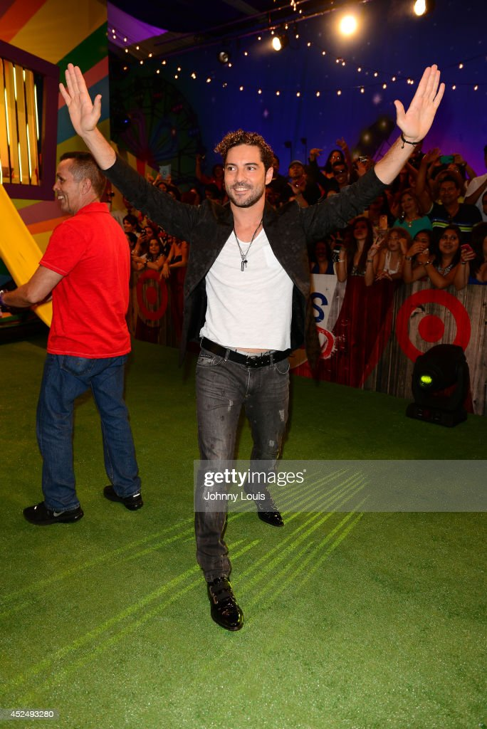 <a gi-track='captionPersonalityLinkClicked' href=/galleries/search?phrase=David+Bisbal&family=editorial&specificpeople=206469 ng-click='$event.stopPropagation()'>David Bisbal</a> attends the Premios Juventud 2014 Awards at Bank United Center on July 17, 2014 in Miami, Florida.