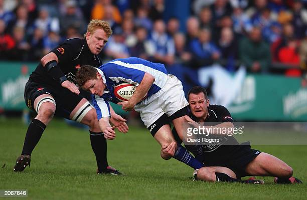 David Bishop of Bridgend is tackled by Jamie Ringer and Shaun Connor of Neath during the Welsh Premiership match between Bridgend and Neath on May 20...