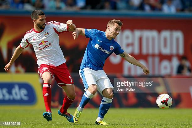 David Blacha of Rostock and Anthony Jung of Leipzig compete for the ball during the third league match between FC Hansa Rostock and RB Leipzig at DKB...