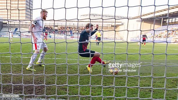 David Blacha of Wiesbaden scores the first goal for his team during the Third Bundesliga match between Wehen Wiesbaden and Hallescher FC at...