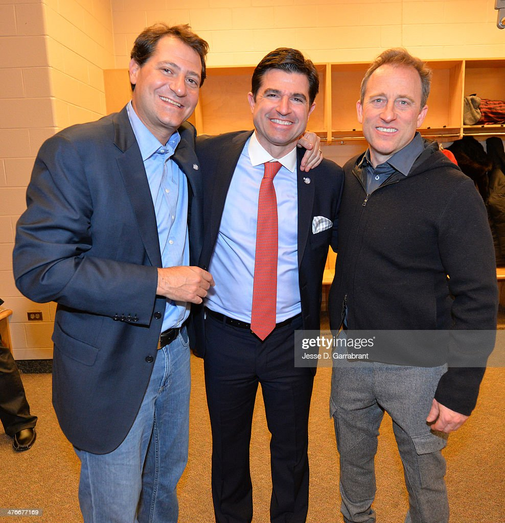 David blitzer;Scott oneil; Josh Harris pose for a photograph at the Wells Fargo Center March 1, 2014 in Philadelphia, Pennsylvania.