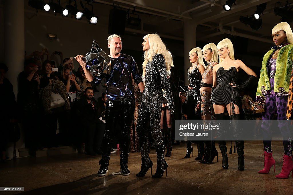 David Blond (L) and Phillipe Blond attend the The Blonds fashion show during MADE Fashion Week Fall 2014 at Milk Studios on February 12, 2014 in New York City.