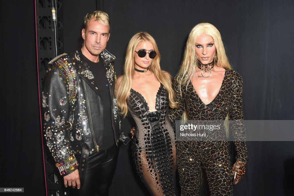 David Blond, Paris Hilton and Phillipe Blond pose backstage at poses backstage for The Blonds fashion show during New York Fashion Week: The Shows at Gallery 1, Skylight Clarkson Sq on September 12, 2017 in New York City.