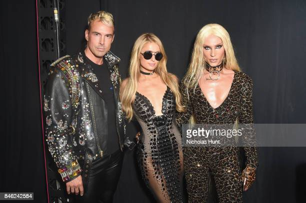 David Blond Paris Hilton and Phillipe Blond pose backstage at poses backstage for The Blonds fashion show during New York Fashion Week The Shows at...