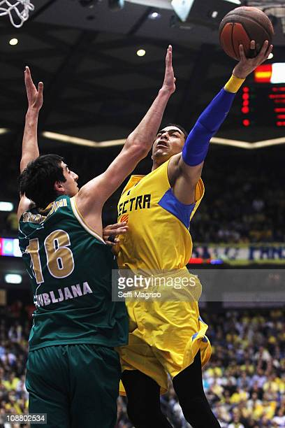 David Blu #7 of Maccabi Electra Tel Aviv in action against Giorgi Shermadini #16 of Union Olimpija during the 20102011 Turkish Airlines Euroleague...