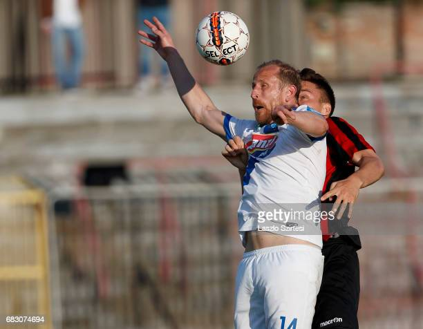 David Bobal of Budapest Honved competes for the ball in the air with Sandor Torghelle of MTK Budapest during the Hungarian OTP Bank Liga match...