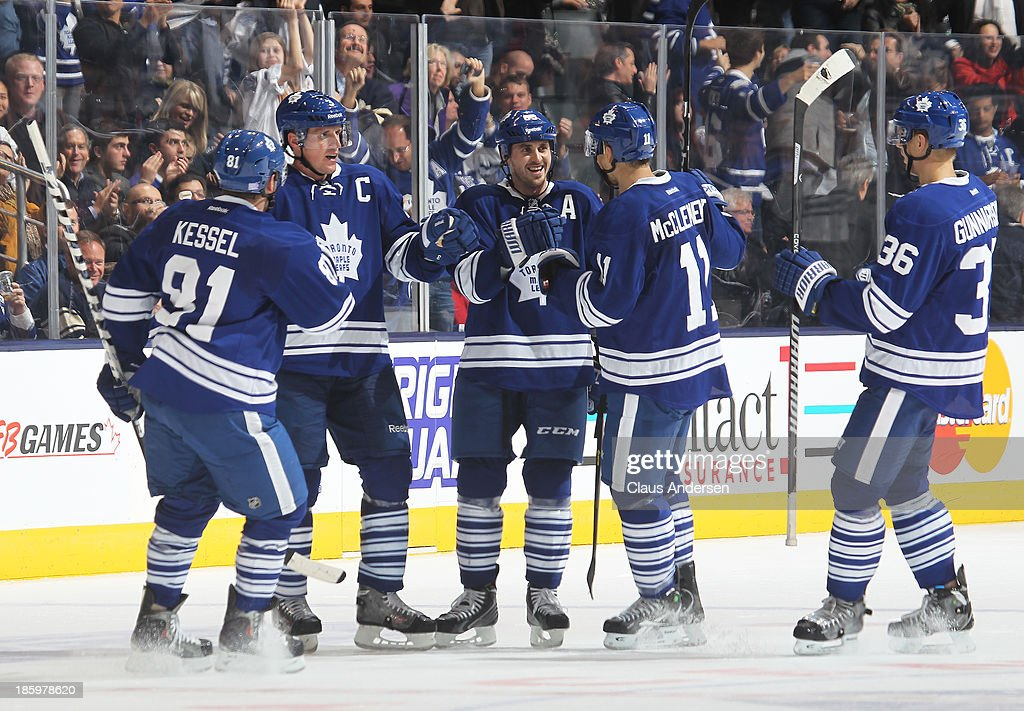 <a gi-track='captionPersonalityLinkClicked' href=/galleries/search?phrase=David+Bolland&family=editorial&specificpeople=210850 ng-click='$event.stopPropagation()'>David Bolland</a> #63 of the Toronto Maple Leafs receives congratulations after scoring into an empty net against the Pittsburgh Penguins during an NHL game at the Air Canada Centre on October 26, 2013 in Toronto, Ontario, Canada. The Leafs defeated the Penguins 4-1.