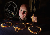 David Booth metal detector enthusiast poses with his hoard of Iron Age Gold on November 4 2009 in Edinburgh Scotland The gold Iron Age torcs were...