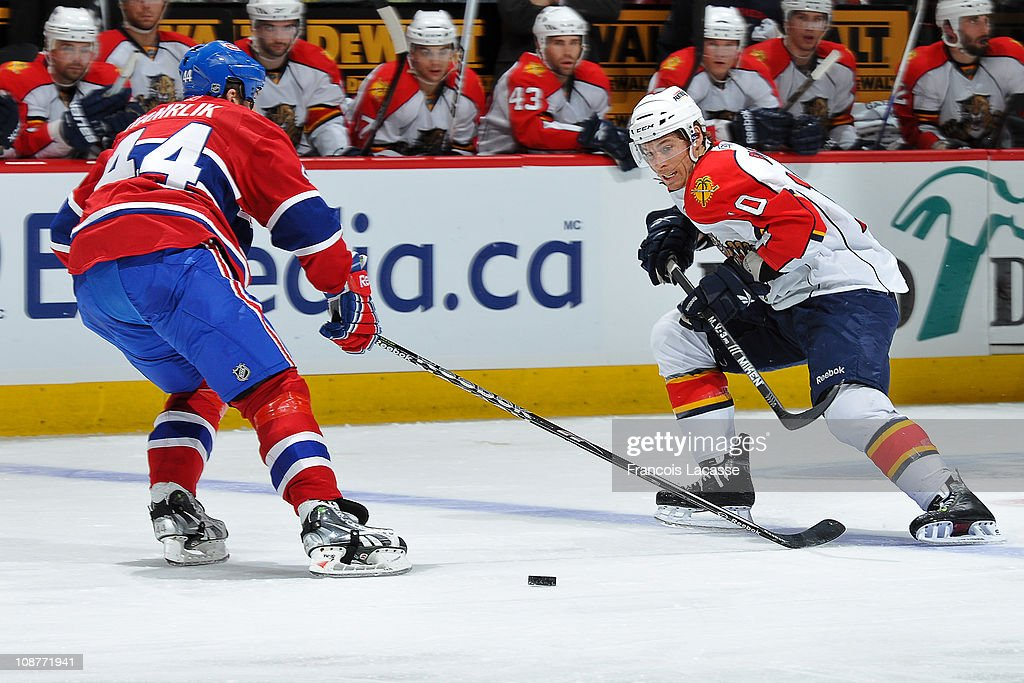 David Booth of the Florida Panthers attempts to skate past defenceman Roman Hamrlik of the Montreal Canadiens during the NHL game on February 2 2011...