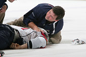 David Booth of the Florida Panthers is attended to by a Medical Trainer after a hit by Mike Richards of the Philadelphia Flyers on October 24 2009 at...