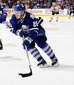 David Booth of the Toronto Maple Leafs carries the puck against the Philadelphia Flyers during NHL game action December 20 2014 at the Air Canada...