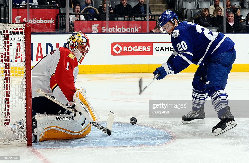 David Booth of the Toronto Maple Leafs puts one on Roberto Luongo of the Florida Panthers during game action on February 17 2015 at Air Canada Centre...