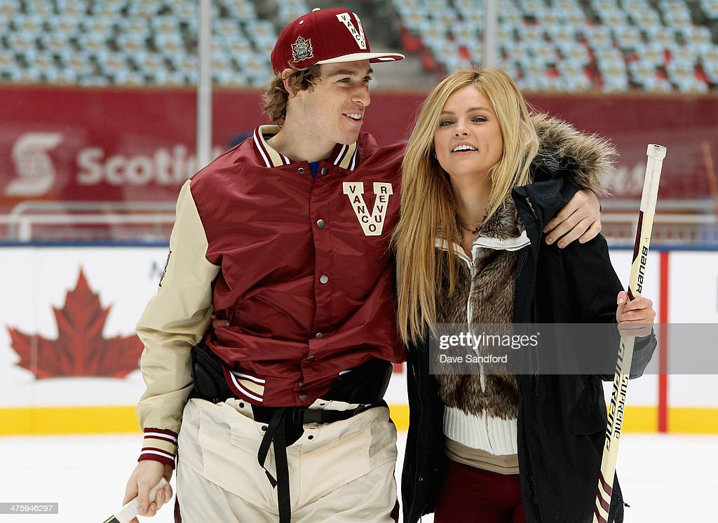 David Booth of the Vancouver Canucks and Ashley Durham recently engaged participate in the family skate as part of he 2014 Tim Hortons NHL Heritage...