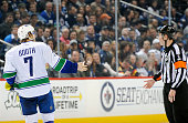 David Booth of the Vancouver Canucks has words with referee Francis Charron after getting called for a histicking penalty during thirdperiod action...