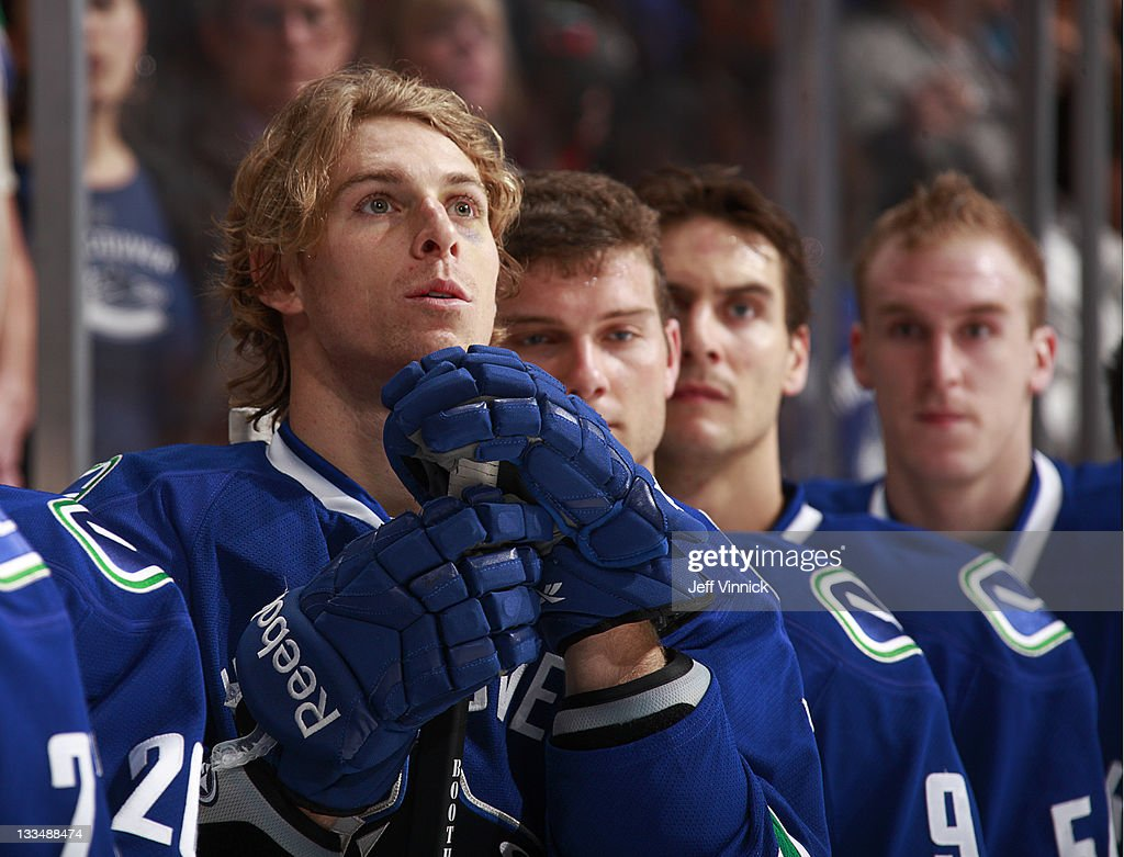 David Booth of the Vancouver Canucks looks on from the bench during their NHL Game against the New York Islanders at Rogers Arena November 13 2011 in...