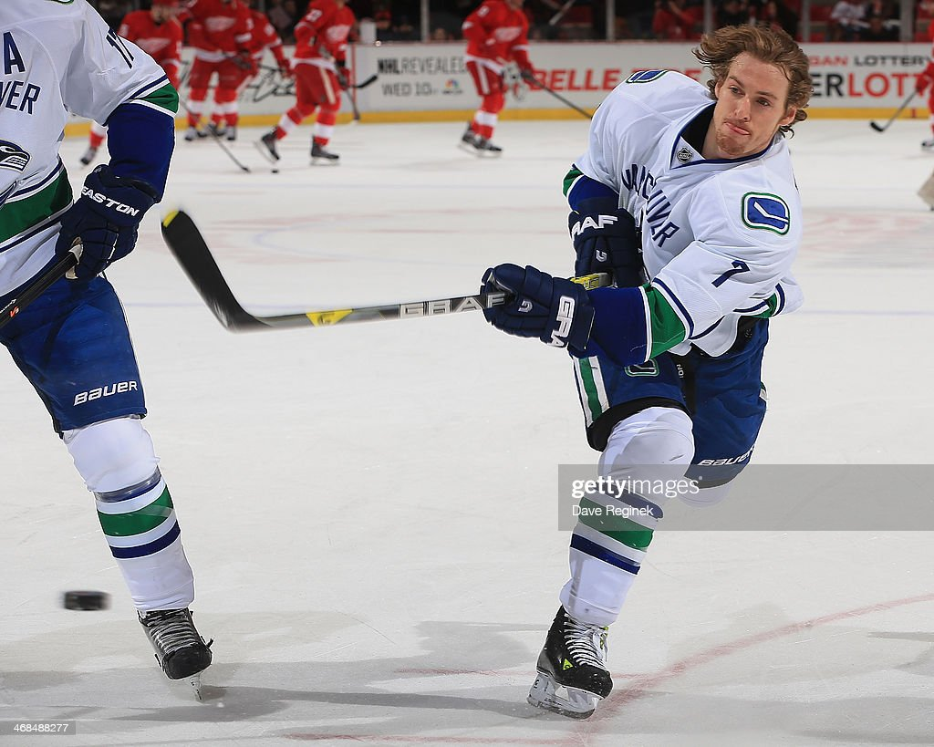 David Booth of the Vancouver Canucks shoots the puck in warmups prior to the NHL game against the Detroit Red Wings on February 3 2014 at Joe Louis...