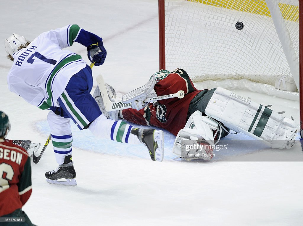 <a gi-track='captionPersonalityLinkClicked' href=/galleries/search?phrase=David+Booth&family=editorial&specificpeople=1109572 ng-click='$event.stopPropagation()'>David Booth</a> #7 of the Vancouver Canucks shoots the puck over Josh Harding #37 of the Minnesota Wild for a goal during the second period of the game on December 17, 2013 at Xcel Energy Center in St Paul, Minnesota.
