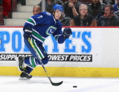 David Booth of the Vancouver Canucks skates up ice with the puck during their NHL game against the Boston Bruins at Rogers Arena December 14 2013 in...