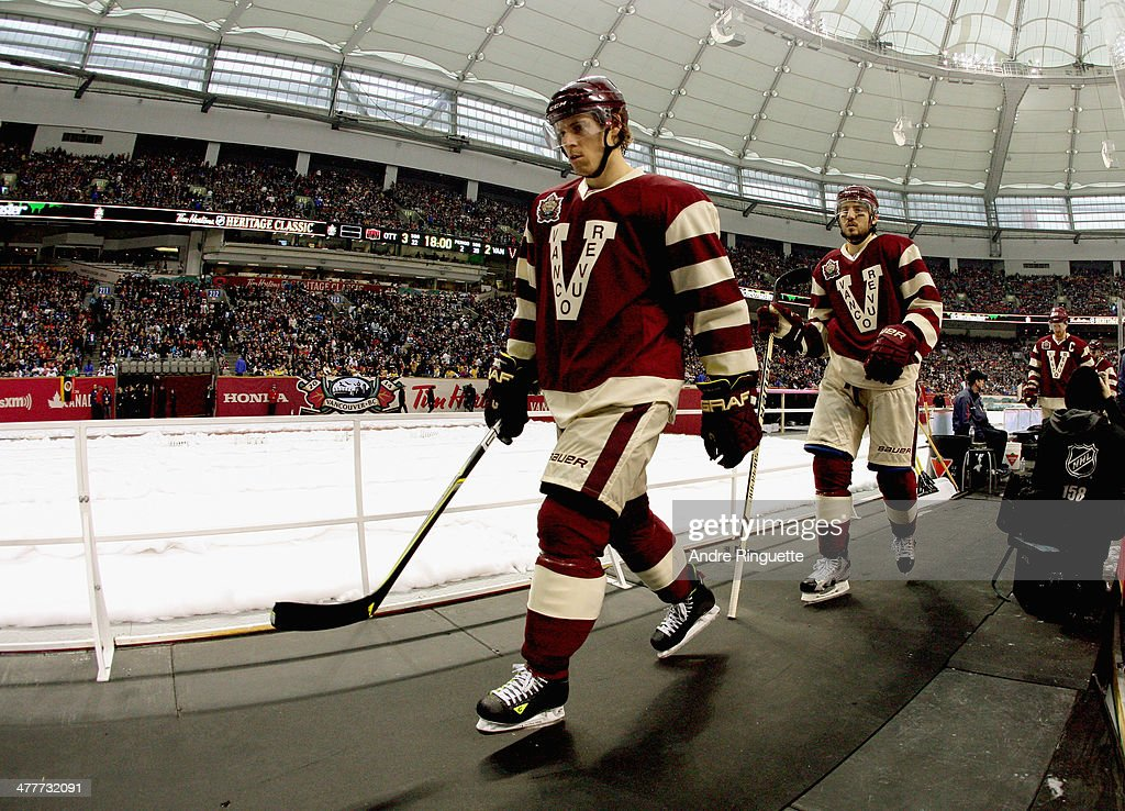 David Booth of the Vancouver Canucks walks out before playing the Ottawa Senators in the 2014 Tim Hortons NHL Heritage Classic game against the...