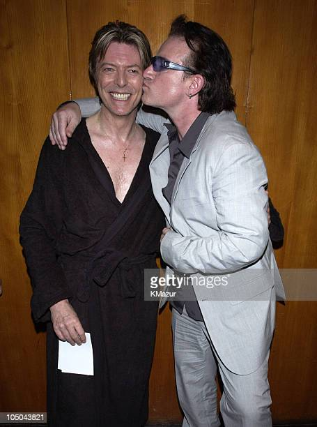 David Bowie and Bono during David Bowie performs at the Meltdown Festival that was curated by David Bowie at Royal Festial Hall in London London...