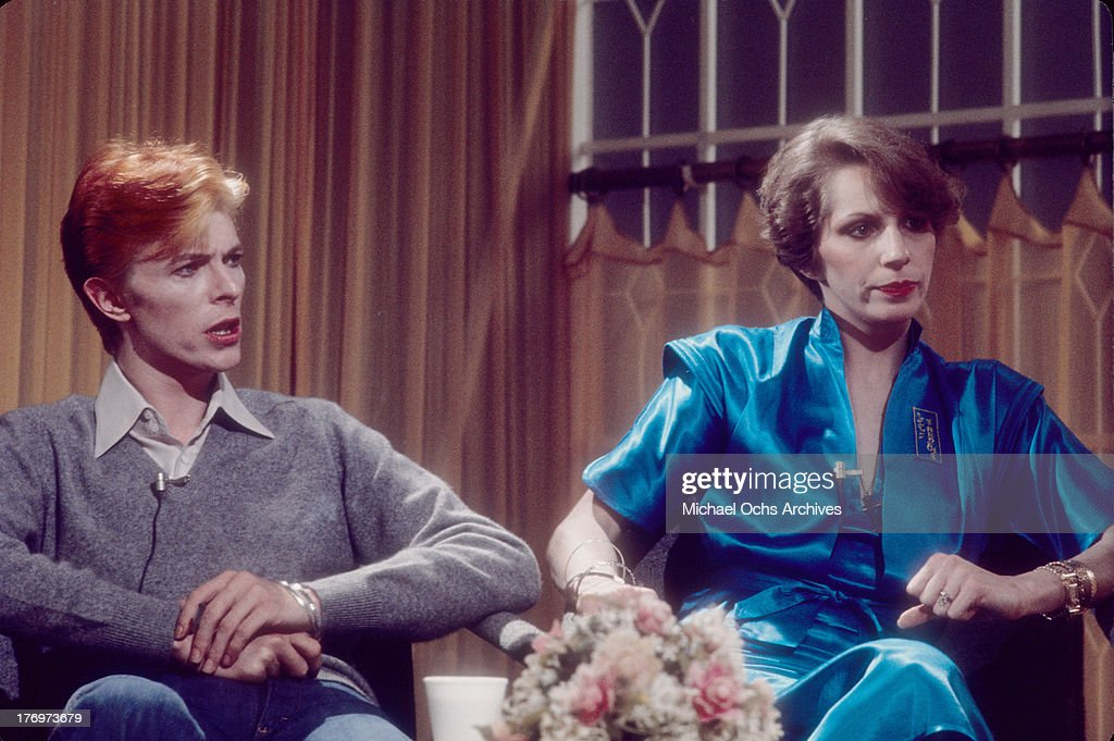 <a gi-track='captionPersonalityLinkClicked' href=/galleries/search?phrase=David+Bowie&family=editorial&specificpeople=171314 ng-click='$event.stopPropagation()'>David Bowie</a> and his wife Angela Bowie are interviewed on 'Good Morning America' by Rona Barrett in February, 1976 in Los Angeles, California.